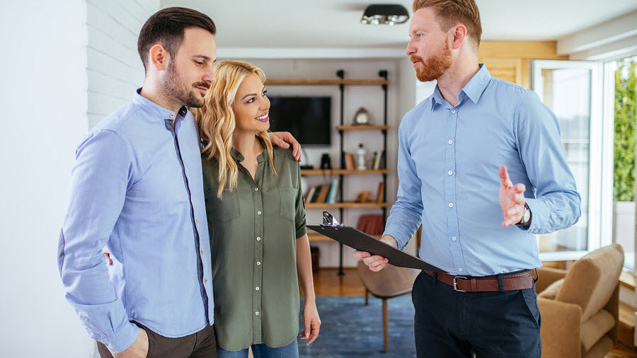 Couple Speaking to Agent
