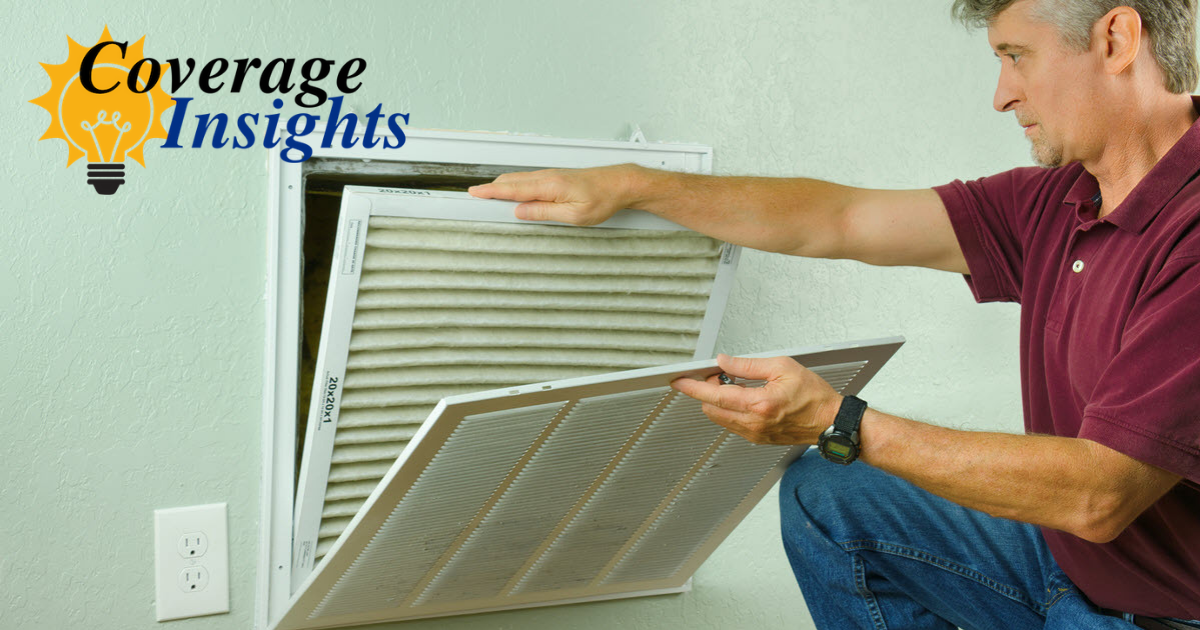 Homeowner changing air conditioning filter