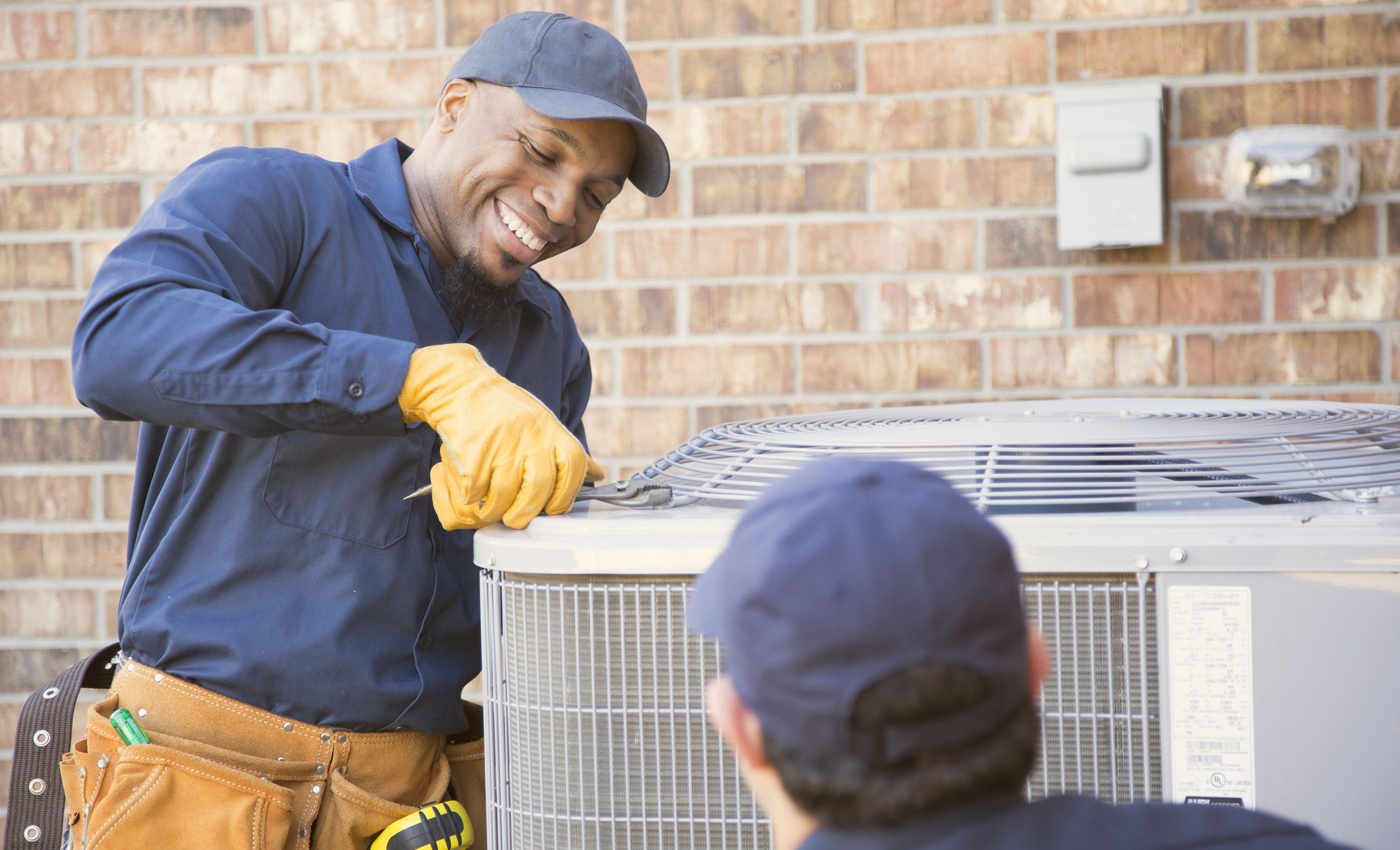 An ORHP network service provider repairs an air conditioning unit.
