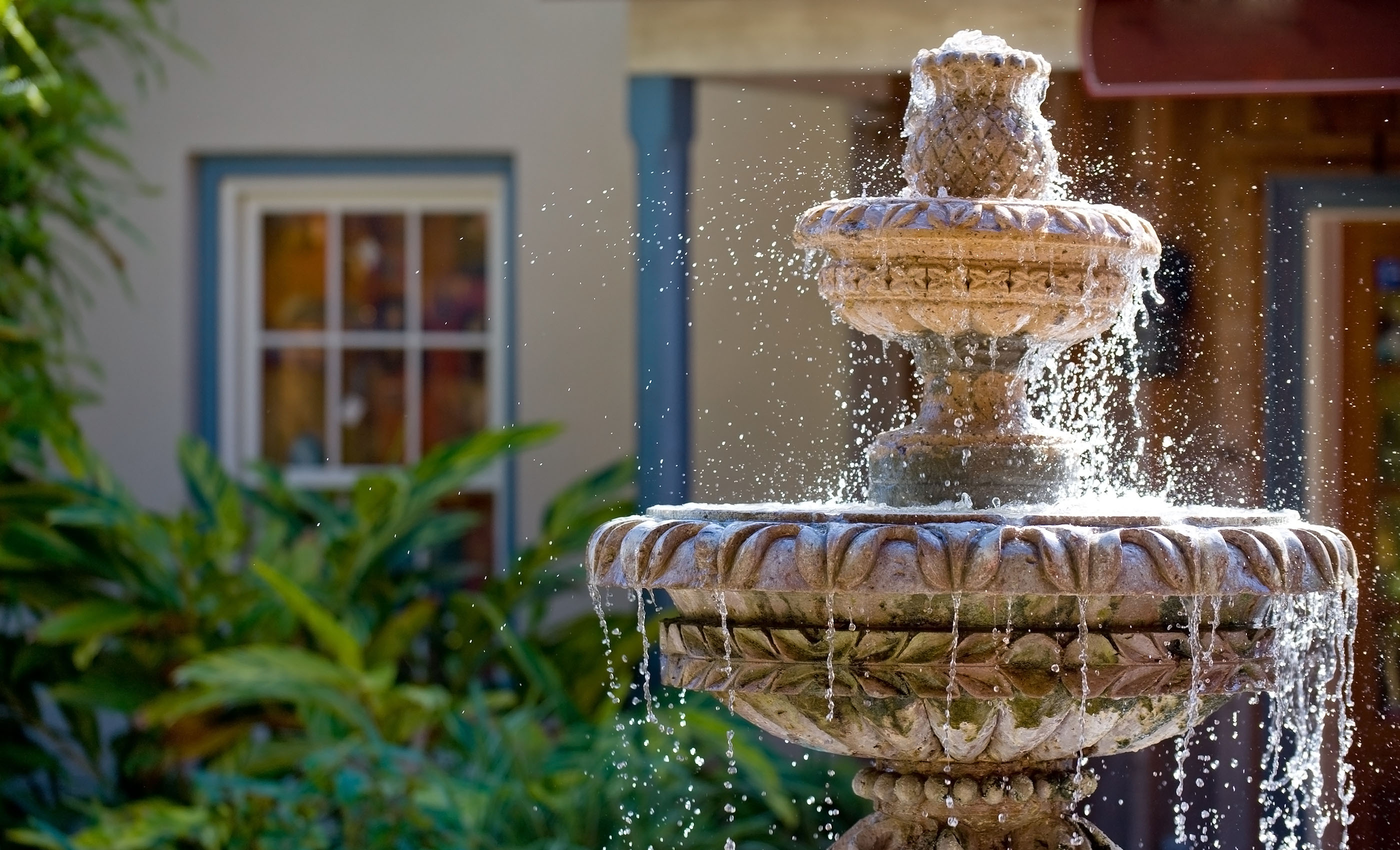 An ornamental fountain outside a buyer's new home.