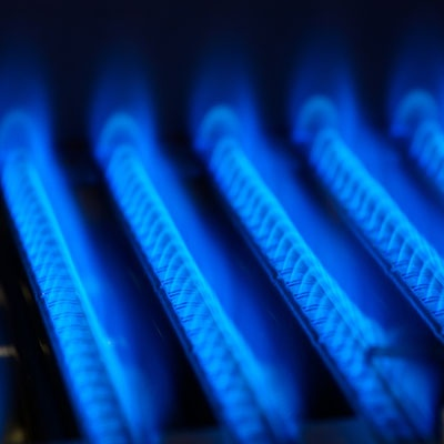 Blue flames inside a gas furnace.